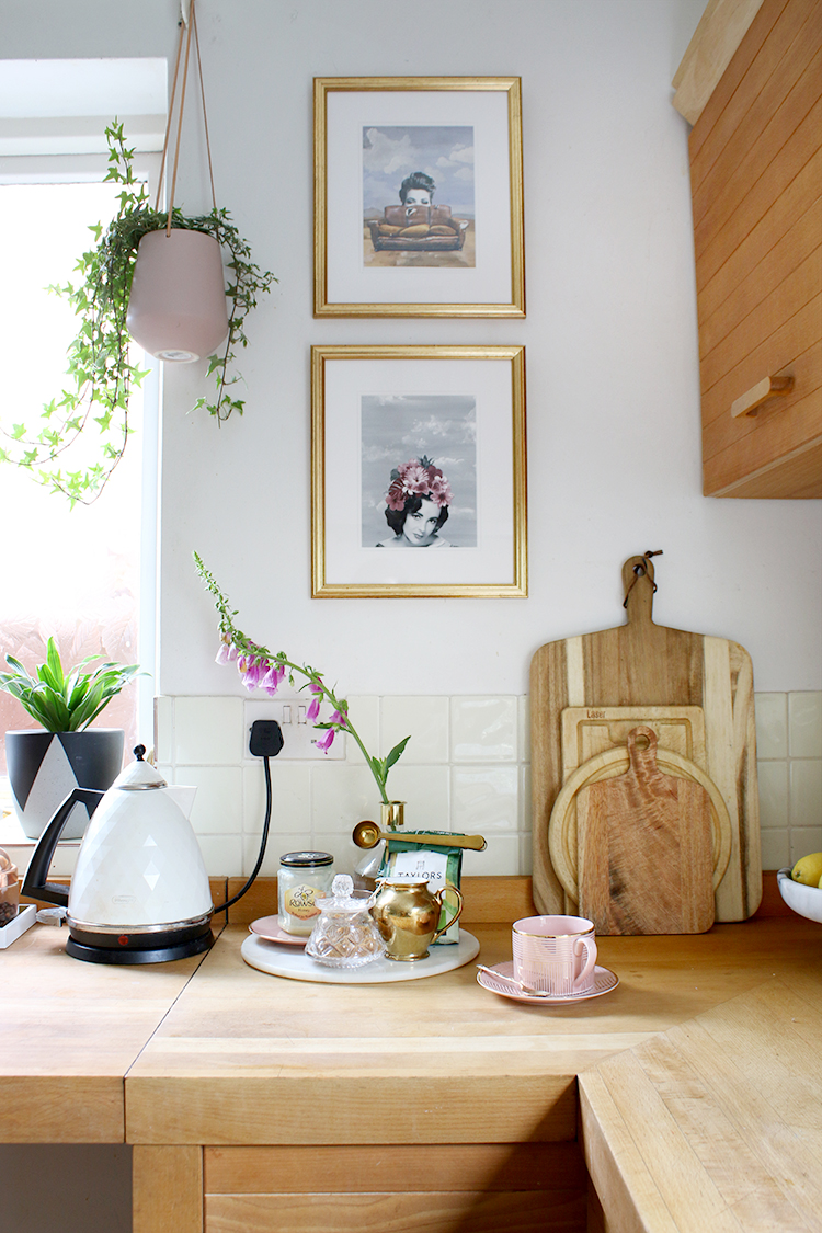 kitchen corner with butcherblock worktops and artwork