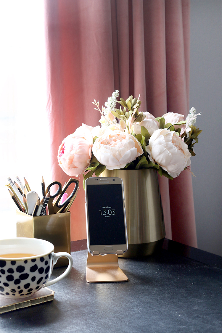 office desk detail with pink peonies, gold accessories and blush pink curtains