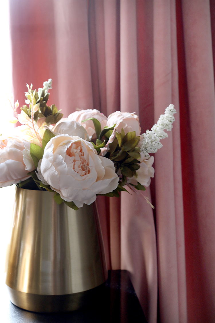 faux peonies in gold vase with blush pink curtains