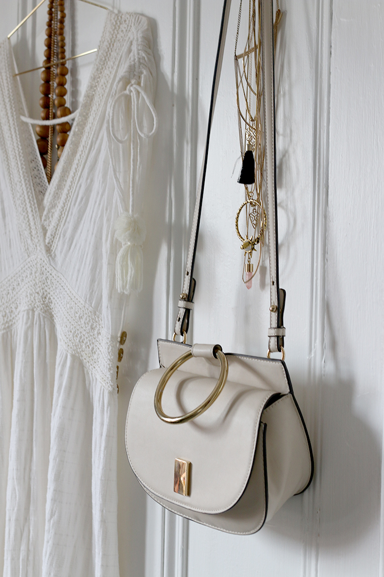 dressing room with white dress and bag from Mango