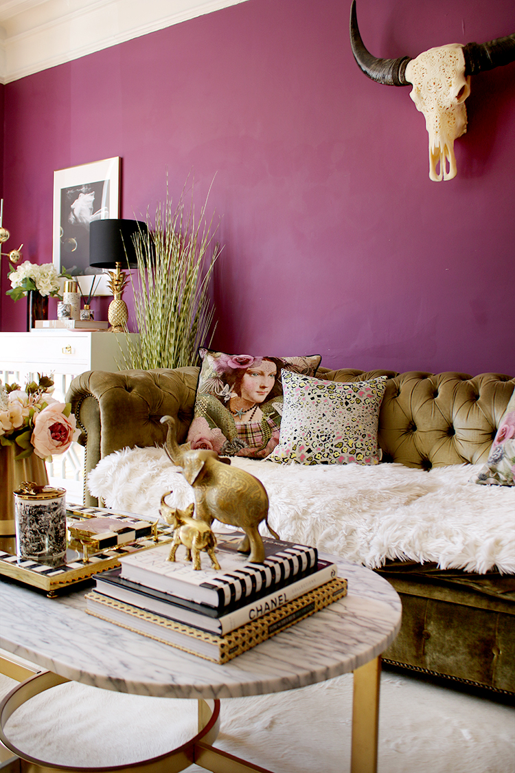 plum living room with romantic cushions and marble coffee table