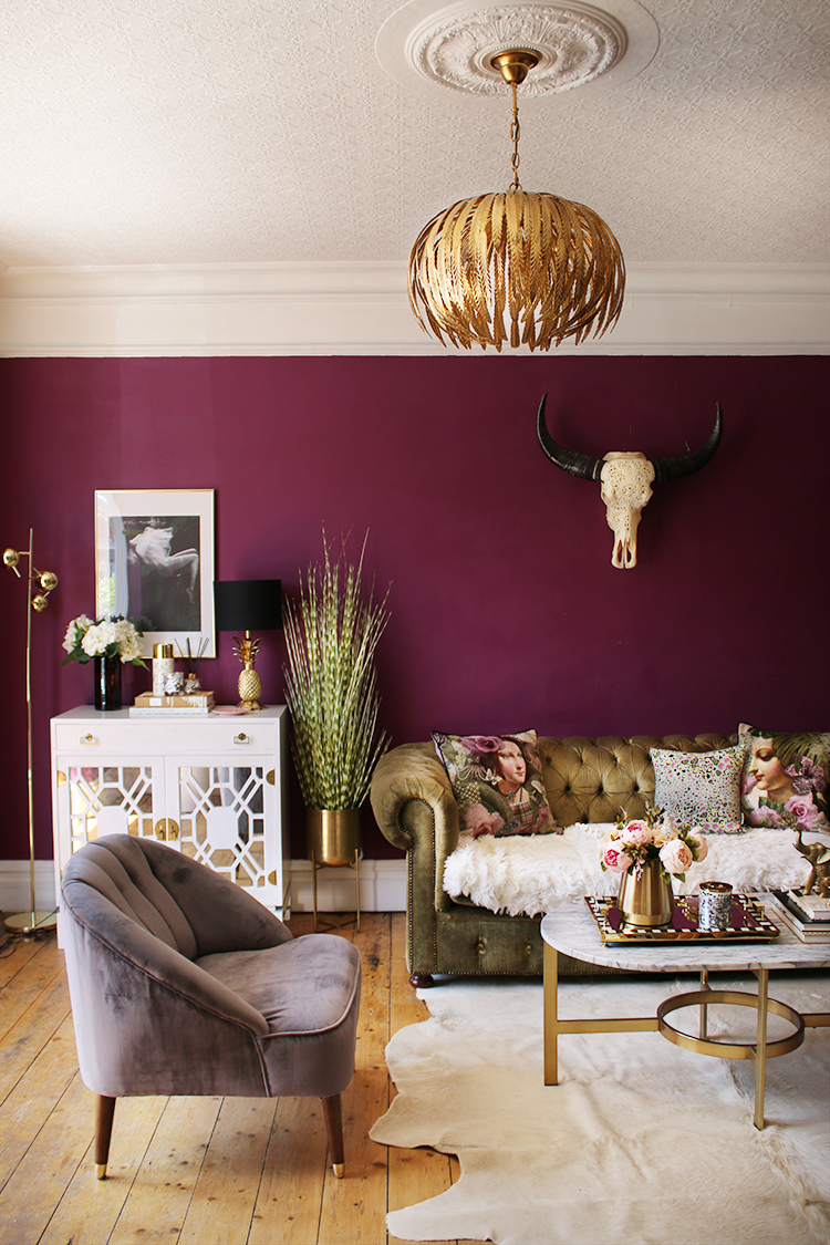boho glam living room in dark berry with gold accents