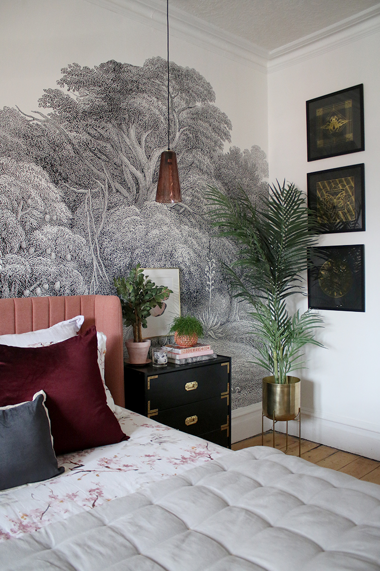 bedroom with wall mural in black white pink and gold
