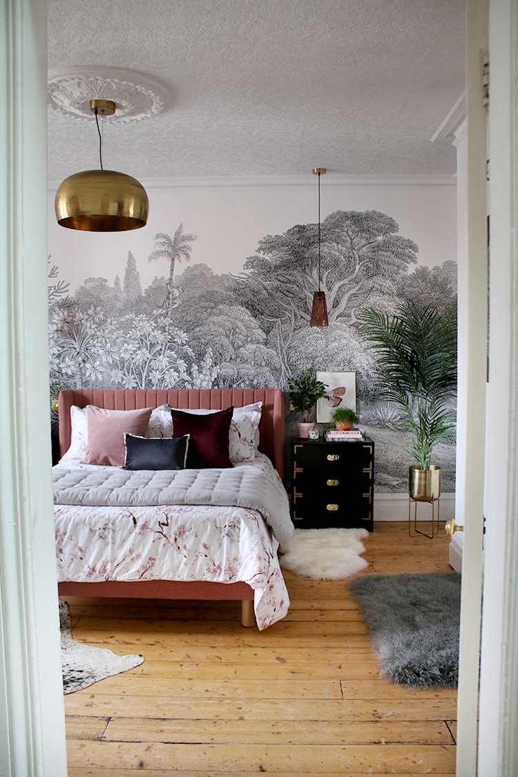 boho jungle glam bedroom with pink bed and pendant lights