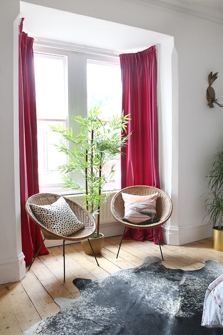 vintage hoop chairs in bay window of Victorian house