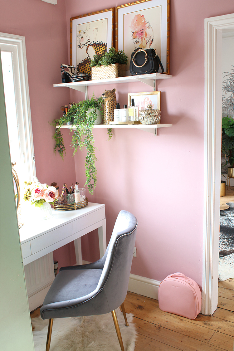 pink vanity room with shelving