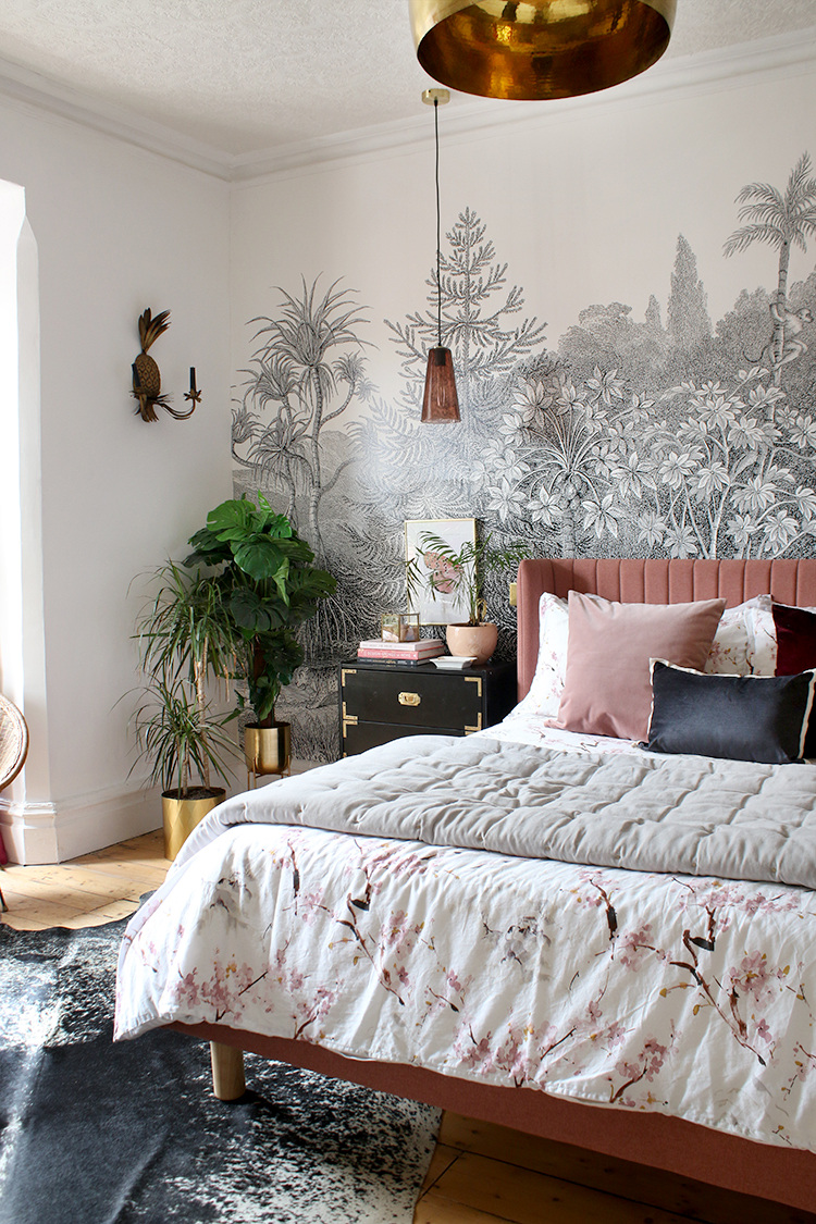pink bed with black and white mural