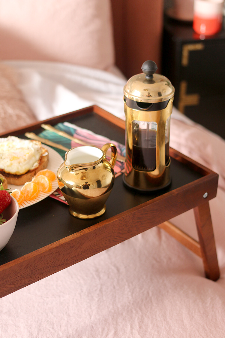 breakfast in bed on pink linen with gold coffee press