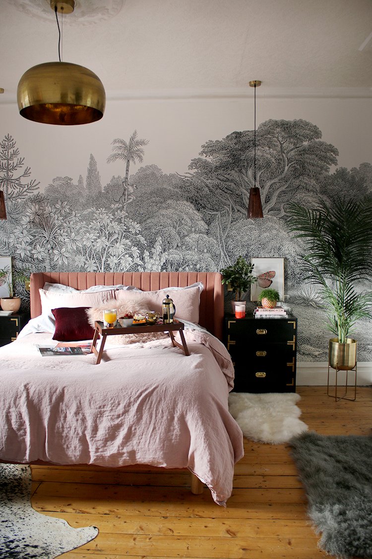 boho glam bedroom with wall mural and pink black and gold accents with linen bedding