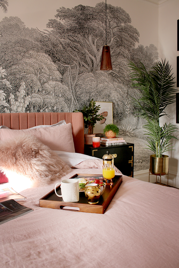 breakfast in bed on pink bedding in boho glam bedroom