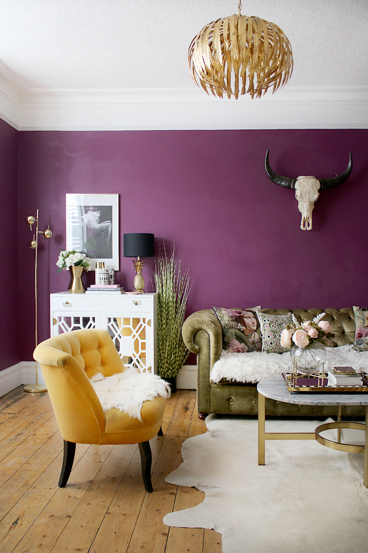 boho glam plum living room with green velvet chesterfield