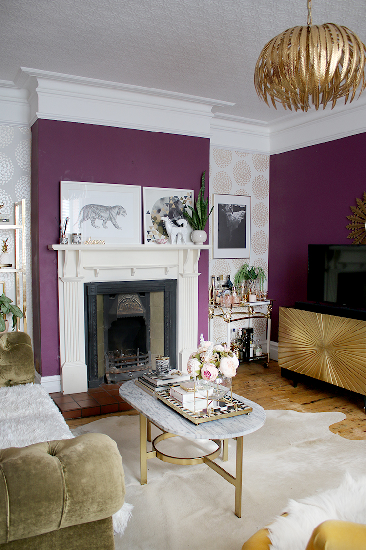 living room with tv and fireplace in dark plum and gold