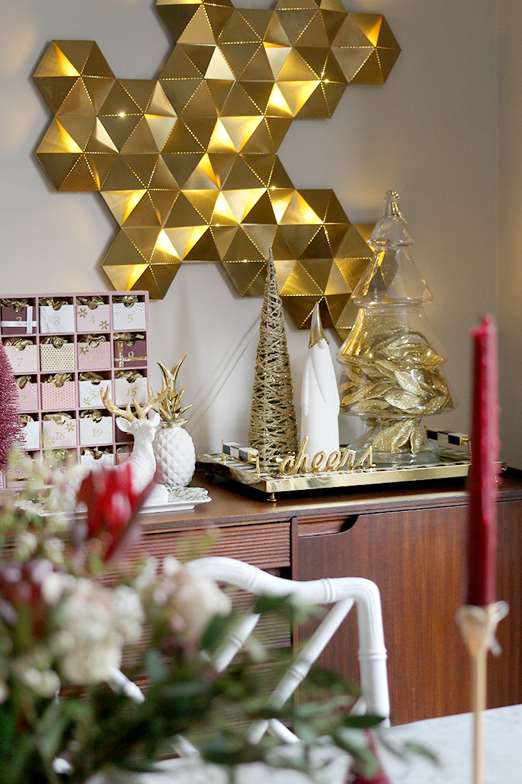 sideboard styling for Christmas in pink burgundy and gold