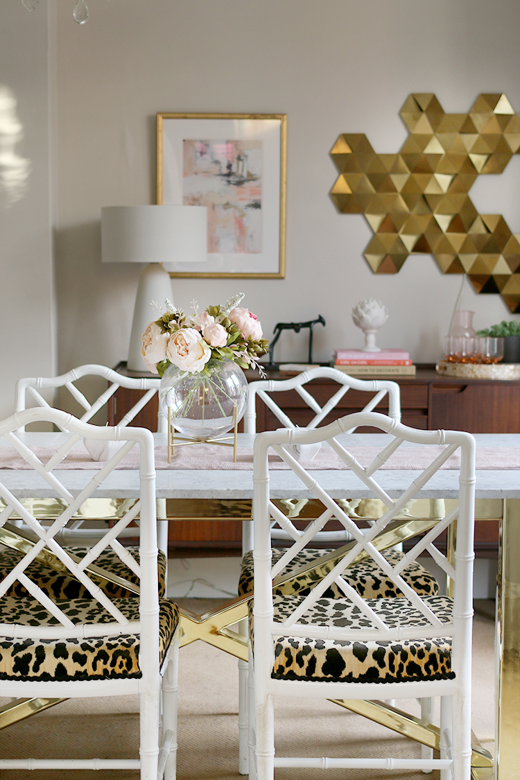dining room with vintage bamboo chairs and marble table