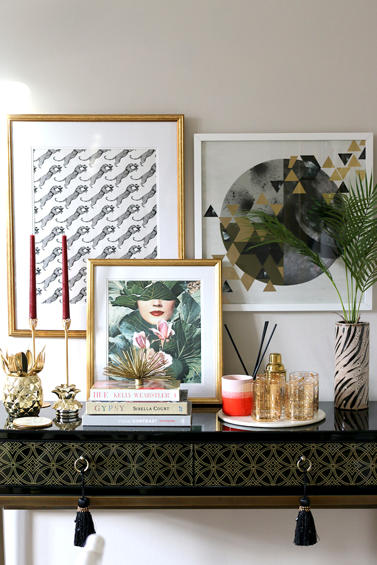black console table styling with gold accents