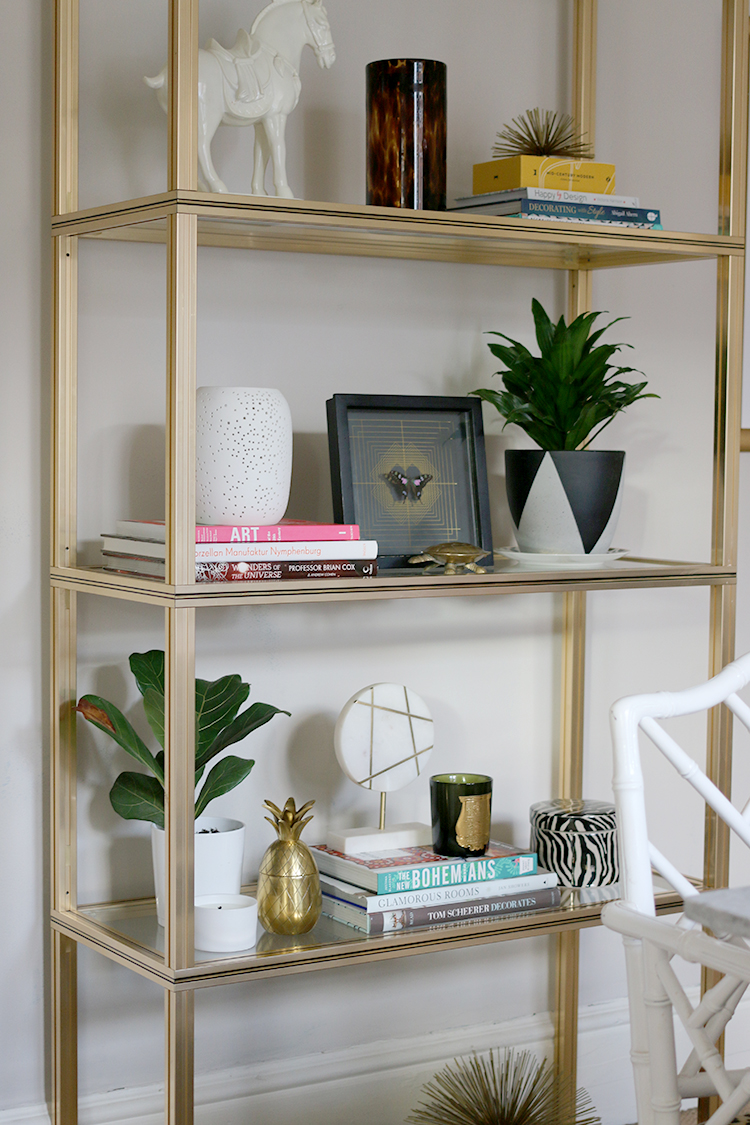 vintage brass shelving unit styling