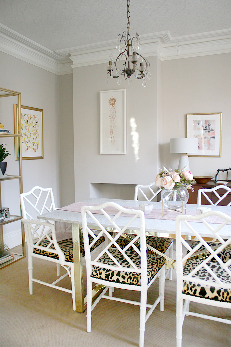 dining room with faux bamboo chairs in light and airy colours