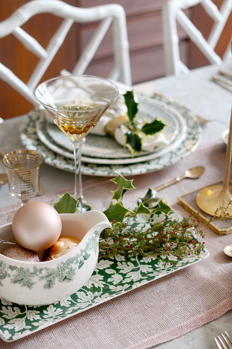 Christmas dinner table setting in green and blush pink