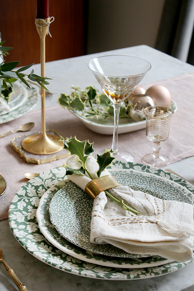 Christmas table setting with holly and greenery styling