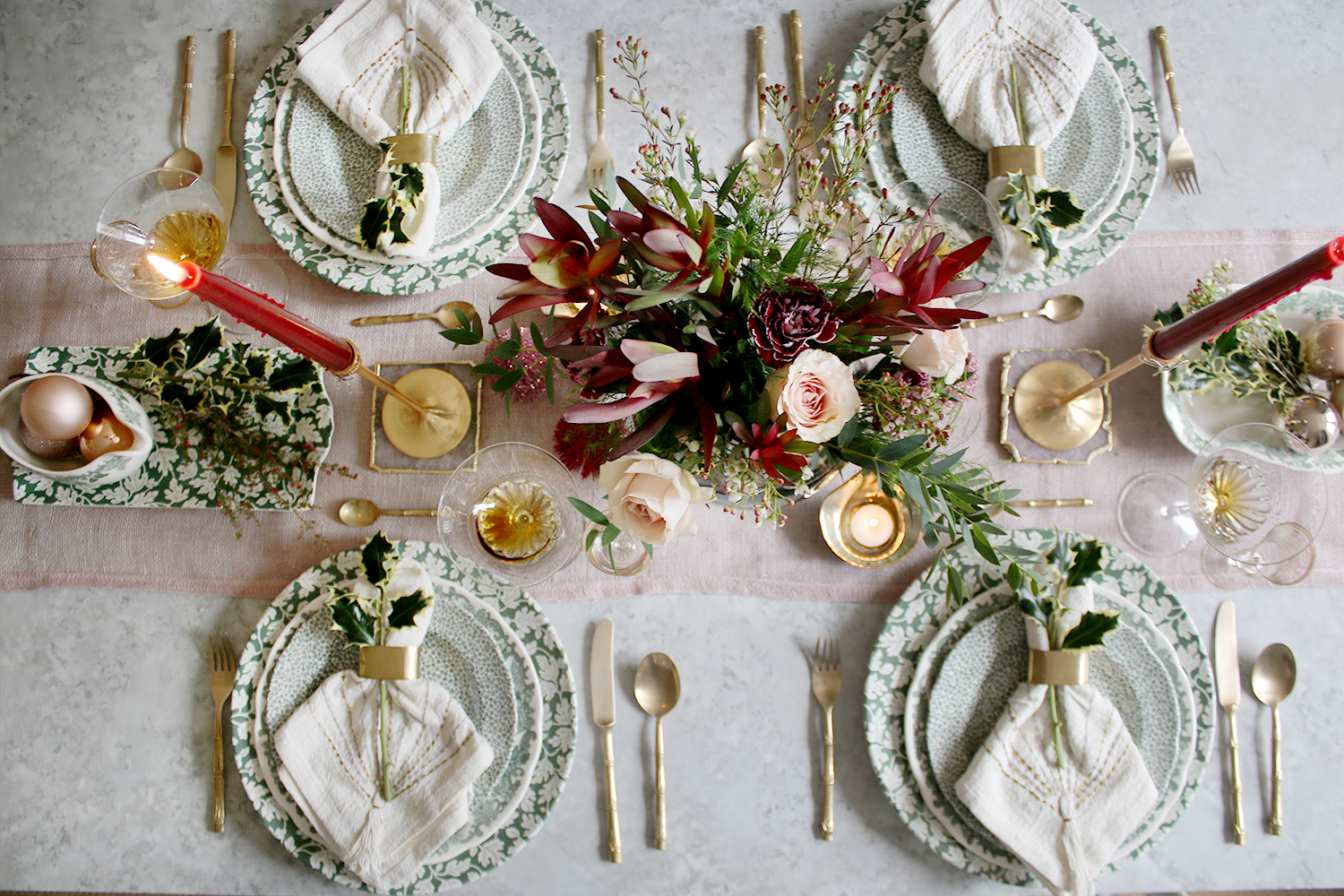 Christmas dinner table setting flatlay in pink and green