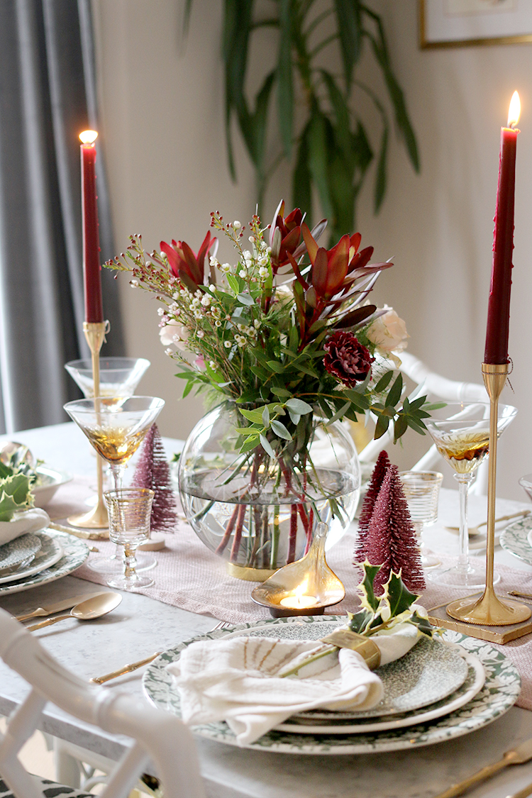 Christmas dinner table setting styling in green and pink