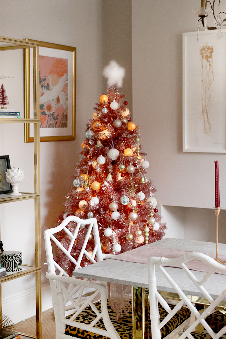 pink christmas tree in dining room