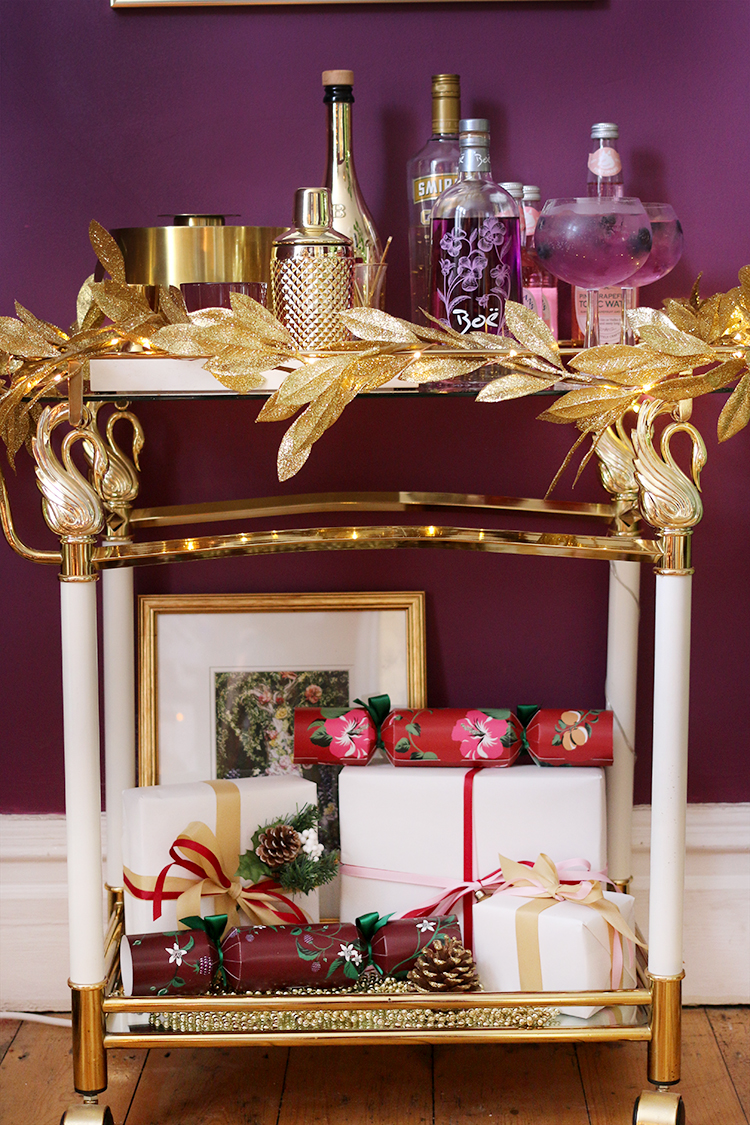 bar cart styling for Christmas in purple and gold