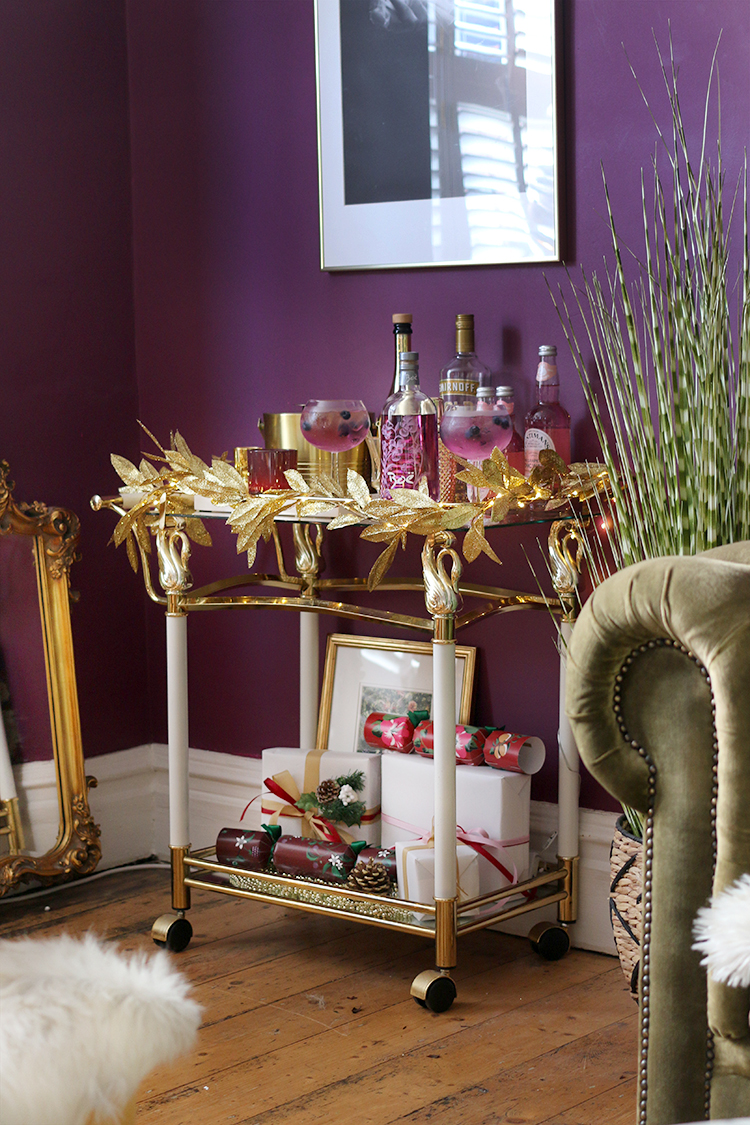 Christmas bar cart styling in gold and dark purple