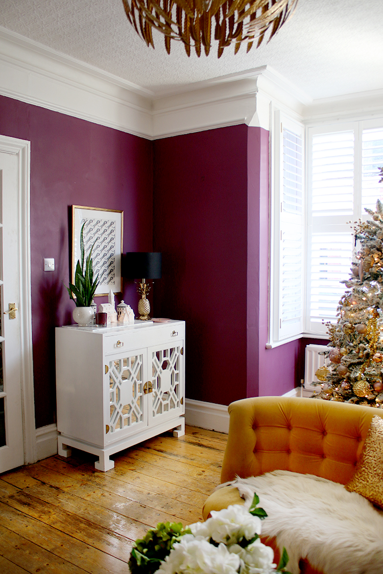 Christmas living room in dark plum and gold
