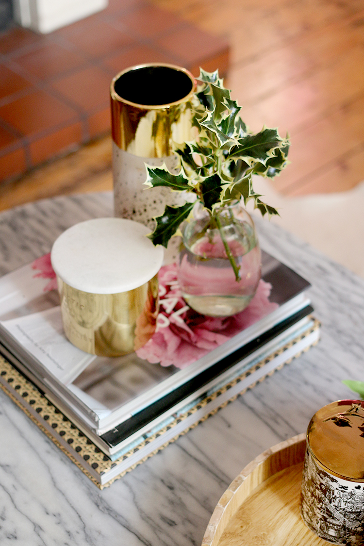 Christmas coffee table styling detail with holly