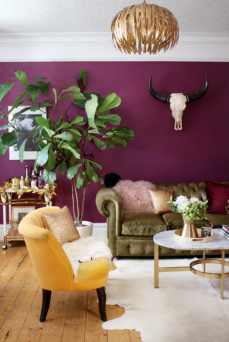 Christmas living room decor in deep plum, pink and gold