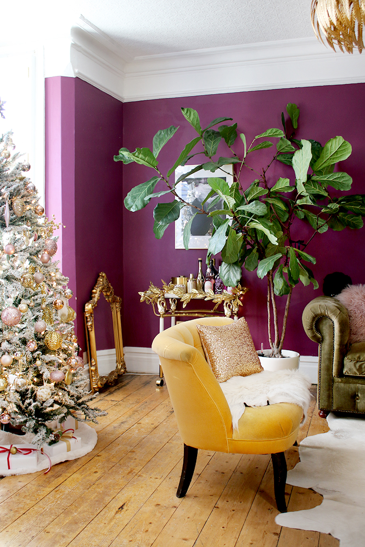Christmas living room in dark purple and gold