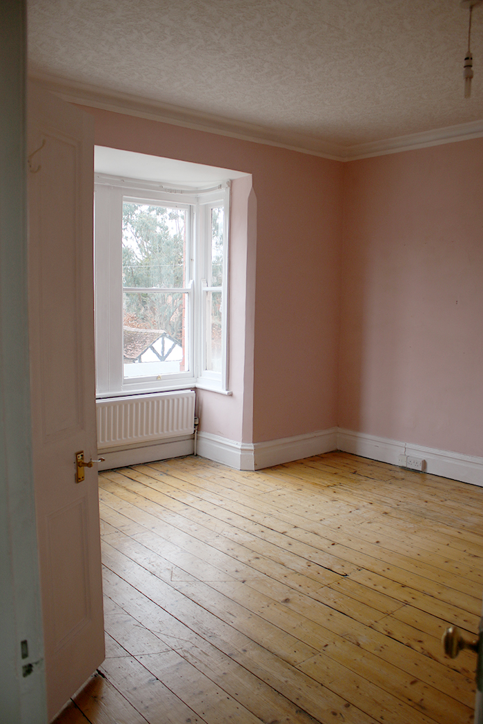 Empty pink room with wood floorboards in Victorian House