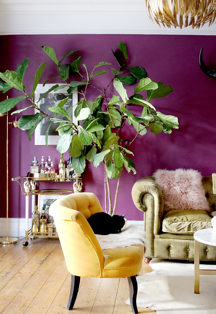 living room with fiddle leaf fig and bar cart