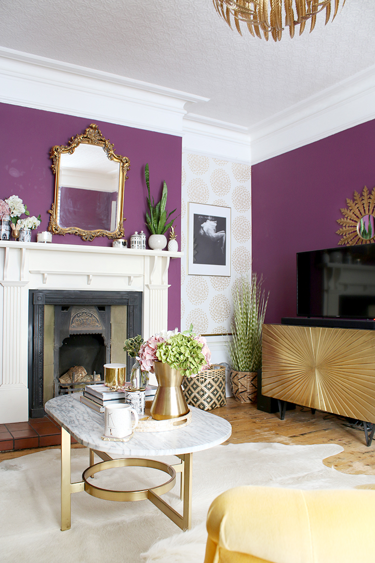 living room with fireplace and gold cabinet in Victorian home