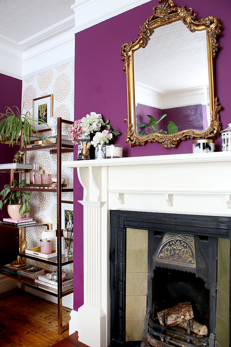fireplace mantle styling with gold mirror and vintage shelving