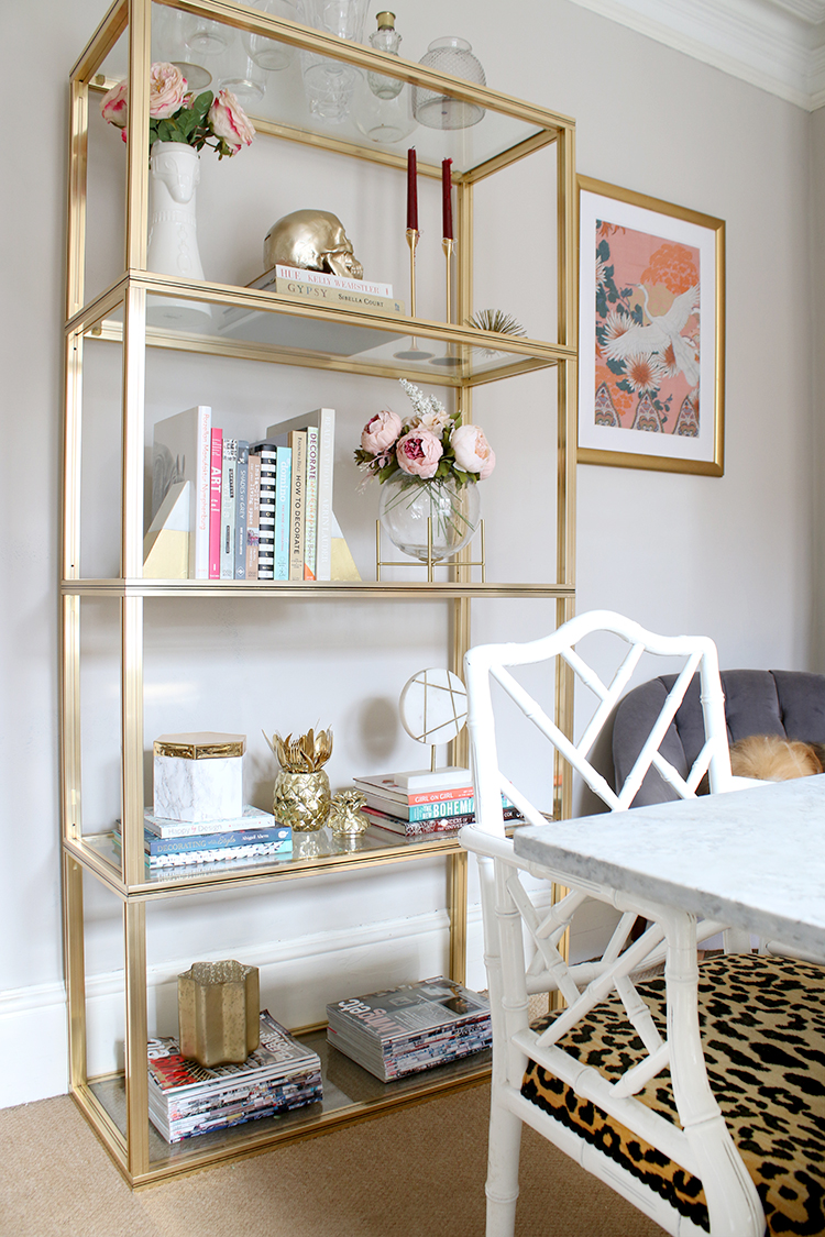 gold shelving unit in dining room
