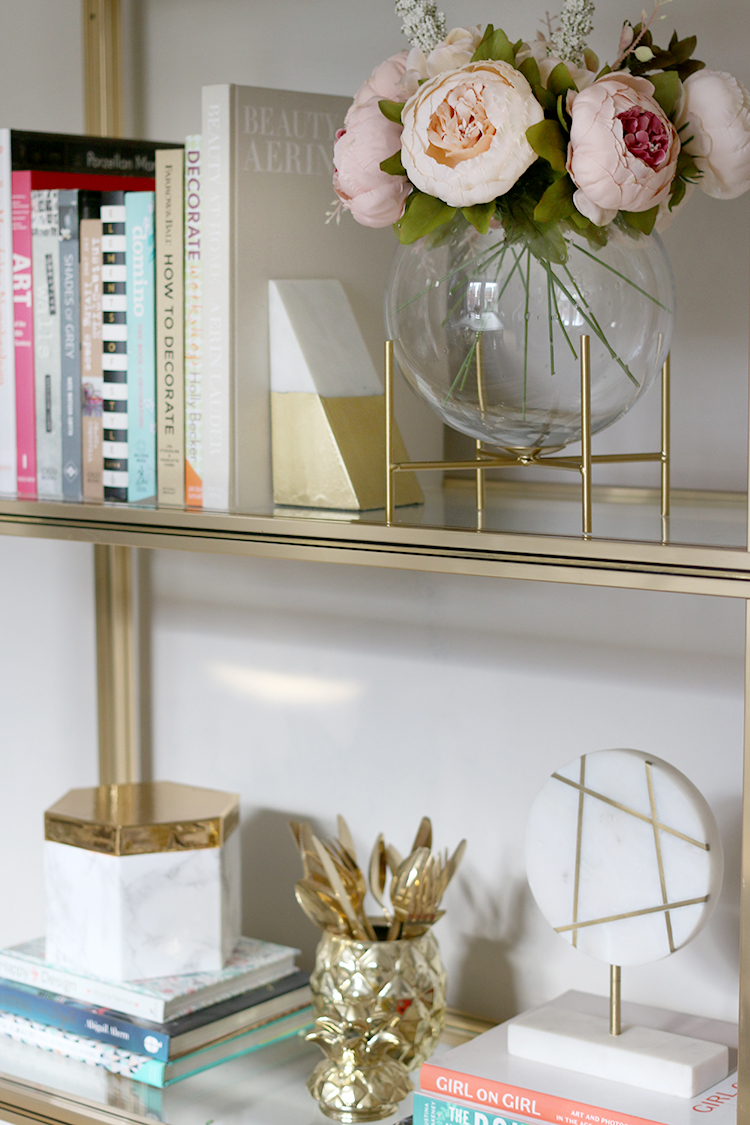 shelf styling detail with marble gold and blush pink accents