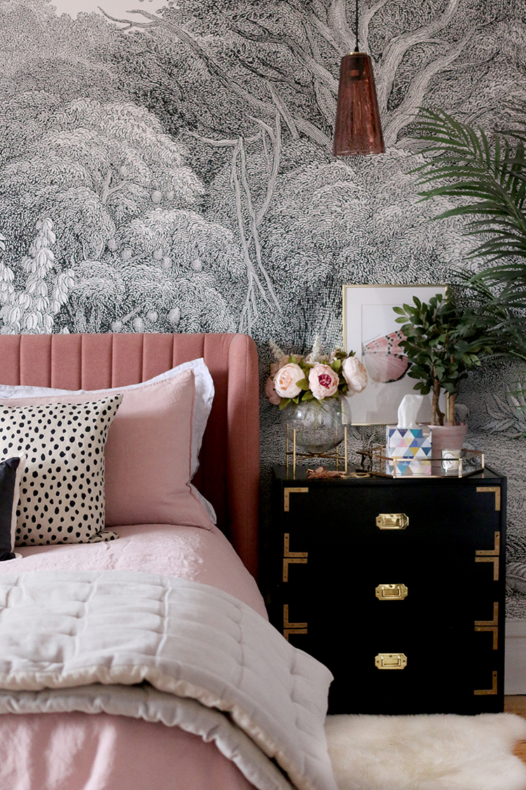pink black and gold bedroom with dalmatian print cushion