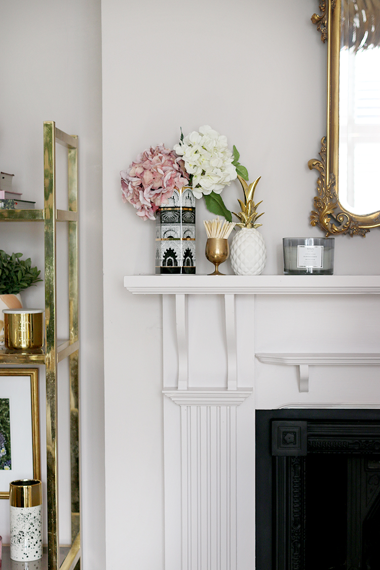 fireplace styling detail with faux hydrangeas and candles