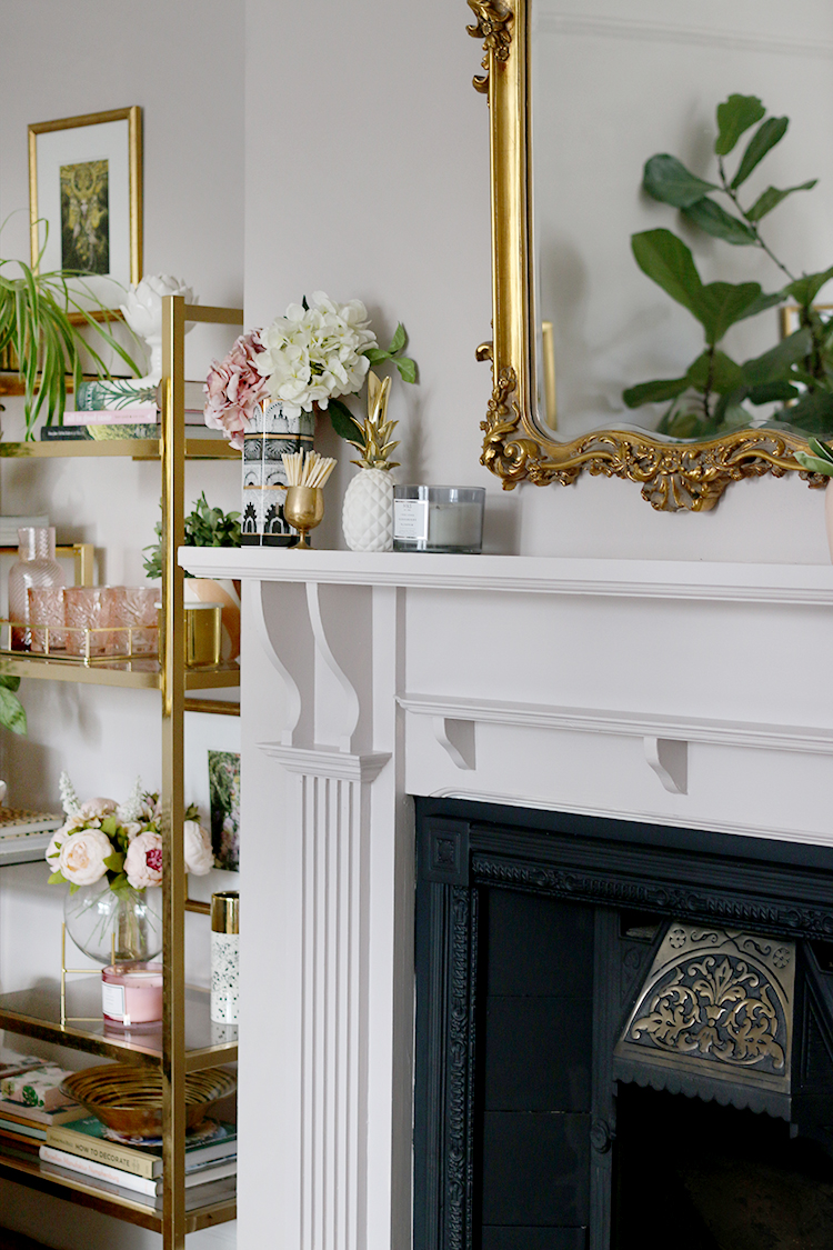 Detail of Victorian fireplace makeover with vintage gold shelving unit