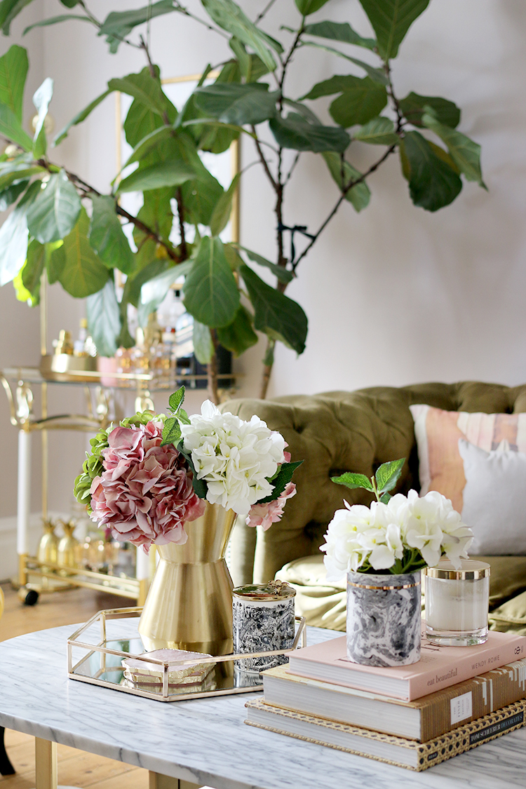 marble coffee table styling with gold and nude