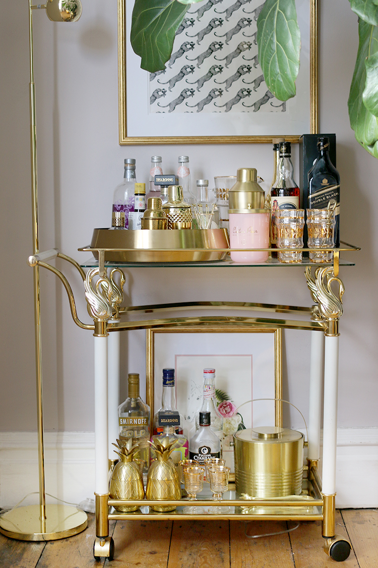 styled bar cart in gold