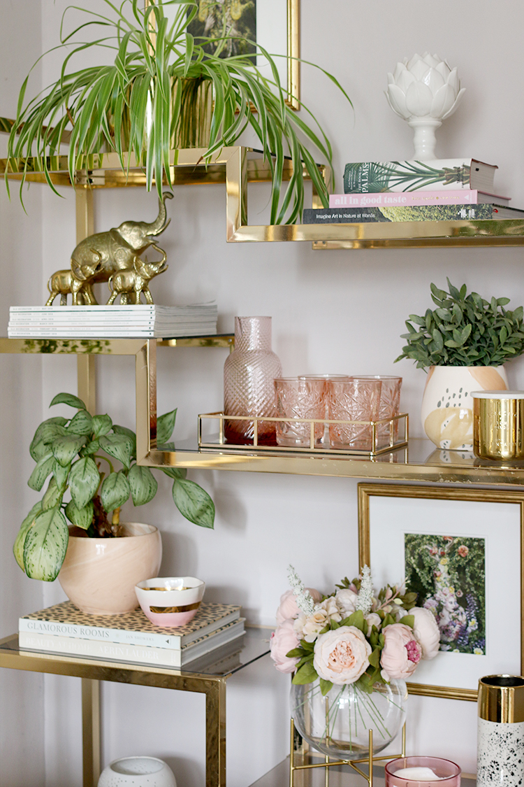 Gold vintage shelving unit styling in blush pink and green