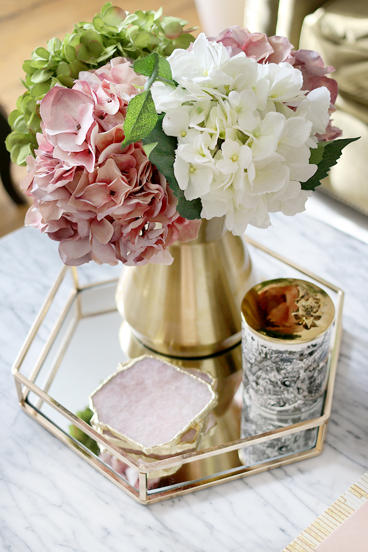 Marble coffee table styling with faux hydrangea and gold and mirror tray