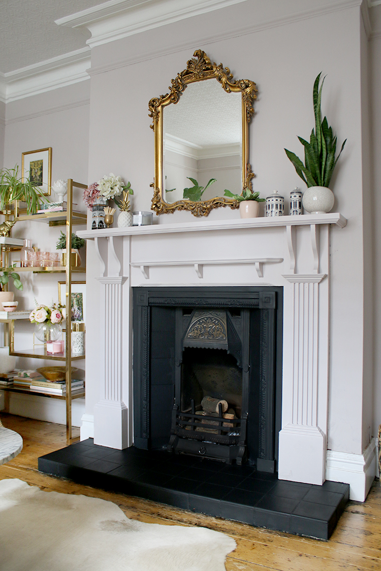 Victorian fireplace makeover in mink with ornate mirror and gold shelving unit