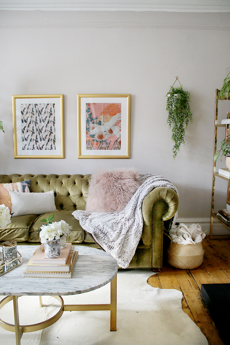 living room styling in pink green and gold