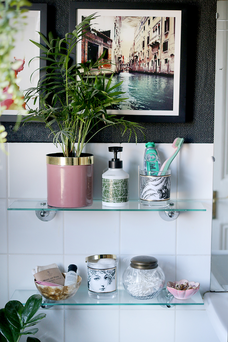 Bathroom storage idea for reusing old candle jars