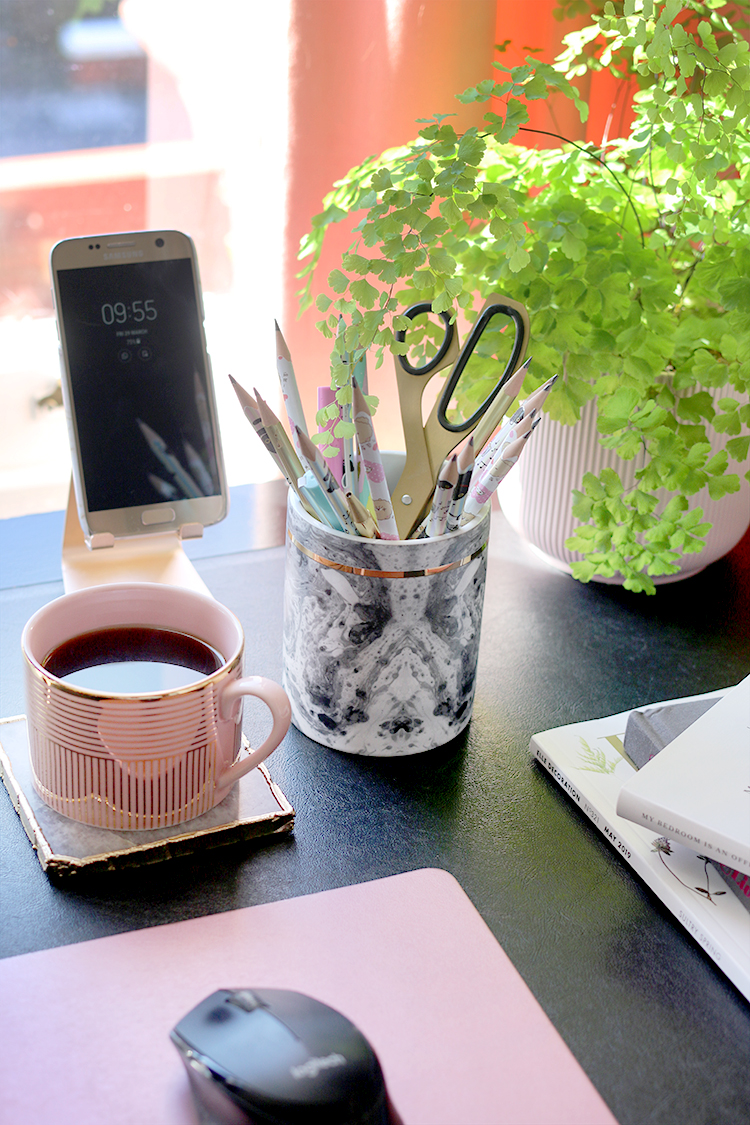 Using leftover candle containers as a desk caddy