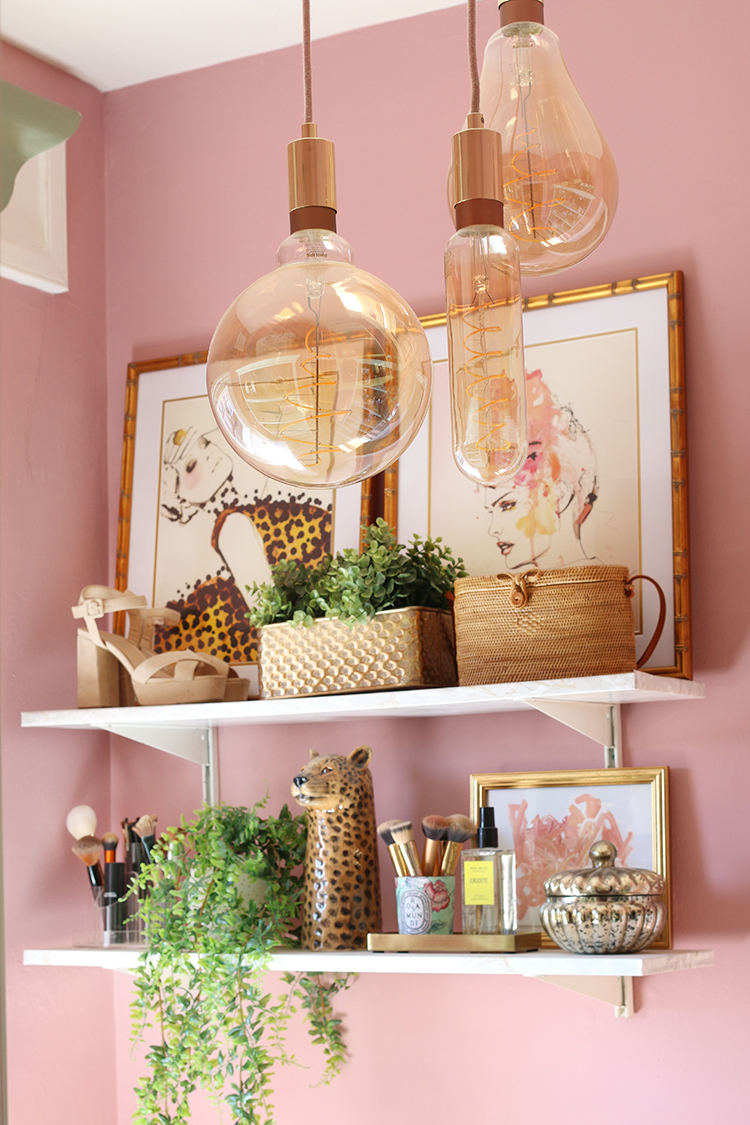 Styled shelf using candles as storage for brushes
